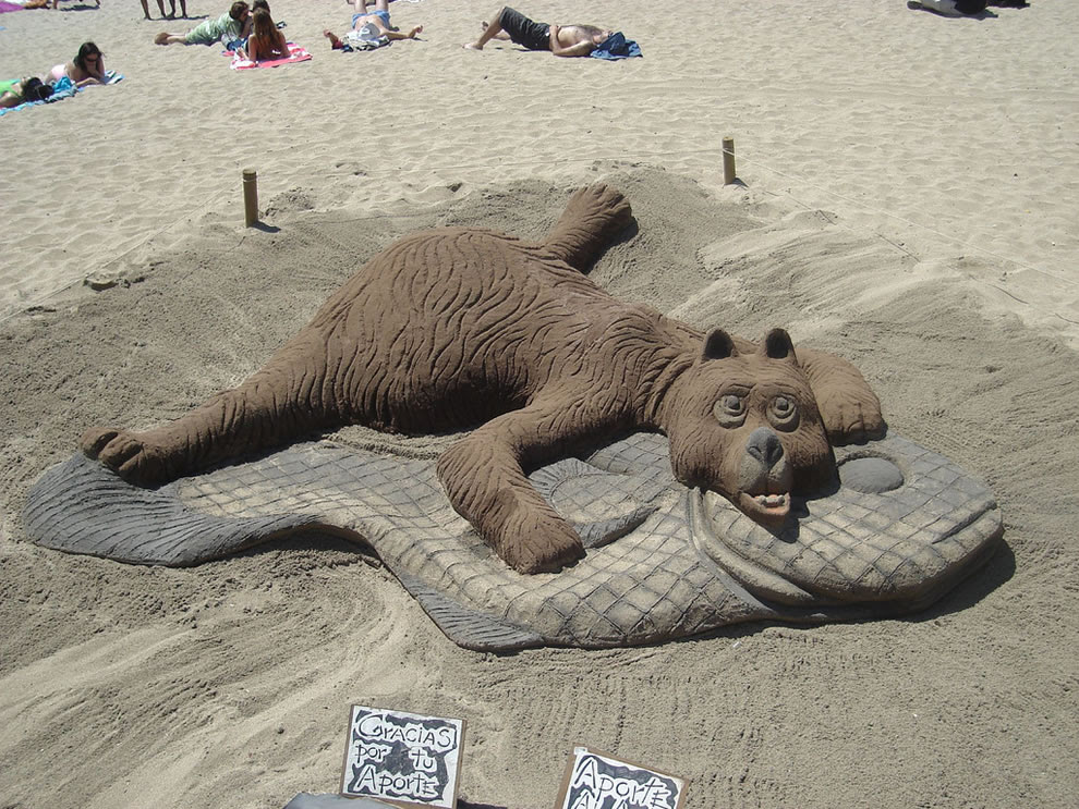 bear on a fish rug animal sand sculpture  sandpainting