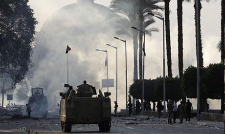 An Egyptian army vehicle outside Cairo University on December 10, 2013. The institution was closed early due to unrest. by Pan-African News Wire File Photos