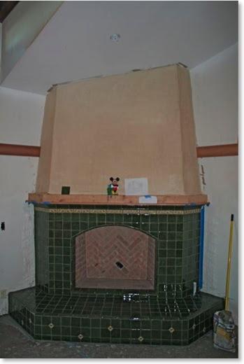 Master bedroom fireplace covered in Batchelder tile.
