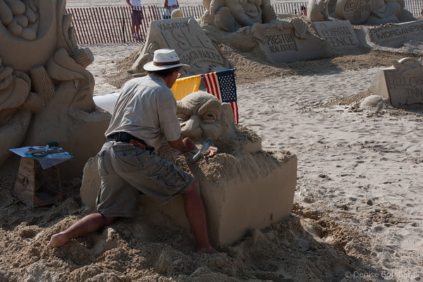 a figure emerging from sand, in the skillful hands of Justin Gordon