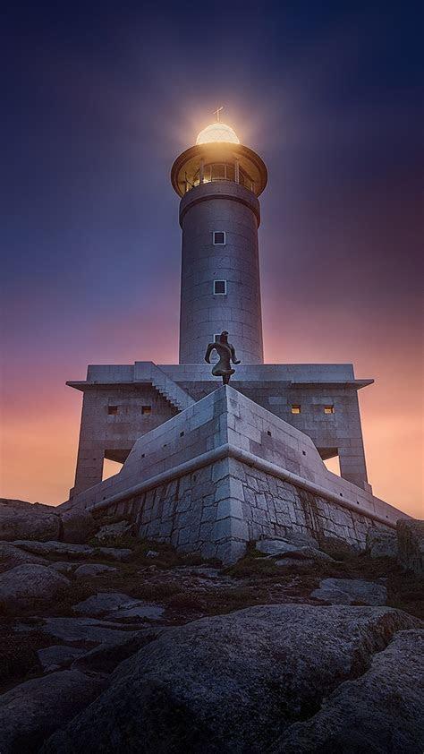 lighthouse rock sunset  pure  ultra hd