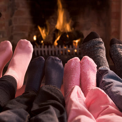 Family sitting by the fireplace