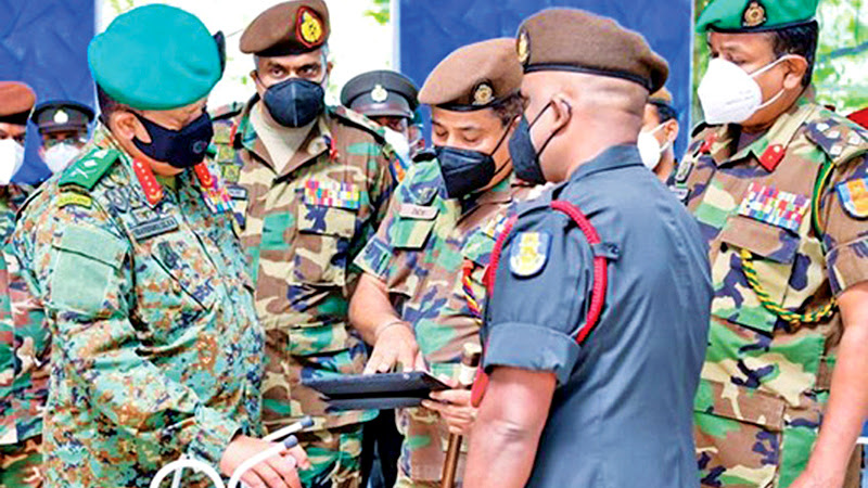 General Shavendra Silva along with others inspecting set of equipment in the Hospital.