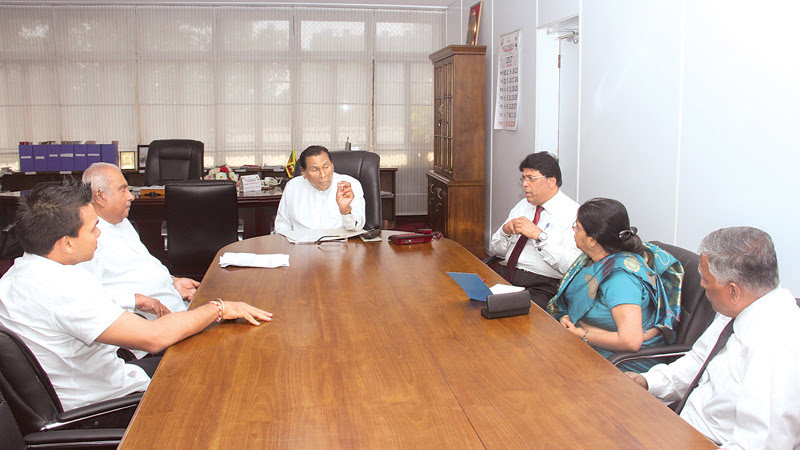 Gamini Lokuge and Namal Rajapaksa discussing labour issues with Labour and Trade Union Relations Minister W.D.J. Senewiratne