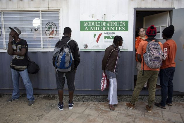 Haitian migrants seek information at the governmental National Migration Institute of Mexico, located next to the Chaparral port of entry, a busy Mexico-U.S. border crossing in the northwestern city of Tijuana. Credit: Guillermo Arias / IPS