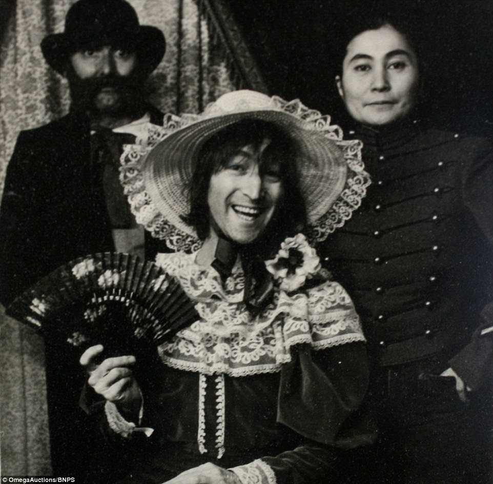 The original black and white pictures from 1977 show John Lennon dressed as a woman in 19th century costume with his his wife Yoko Ono posing as a Civil War soldier and a friend standing at the back