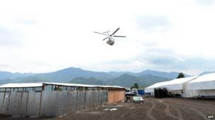 This photo taken on 29 May, 2013, shows a United Nations peacekeeping mission helicopter flying over a UN base camp in Goma.