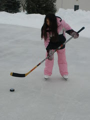 Sophia Playing Hockey