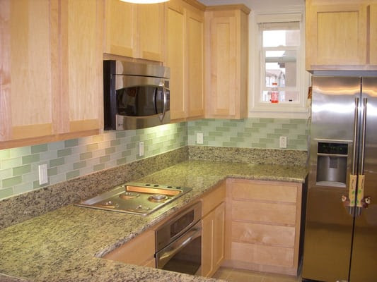 2''x6'' glass tile. Brick lay out pattern, granite counter tops ...