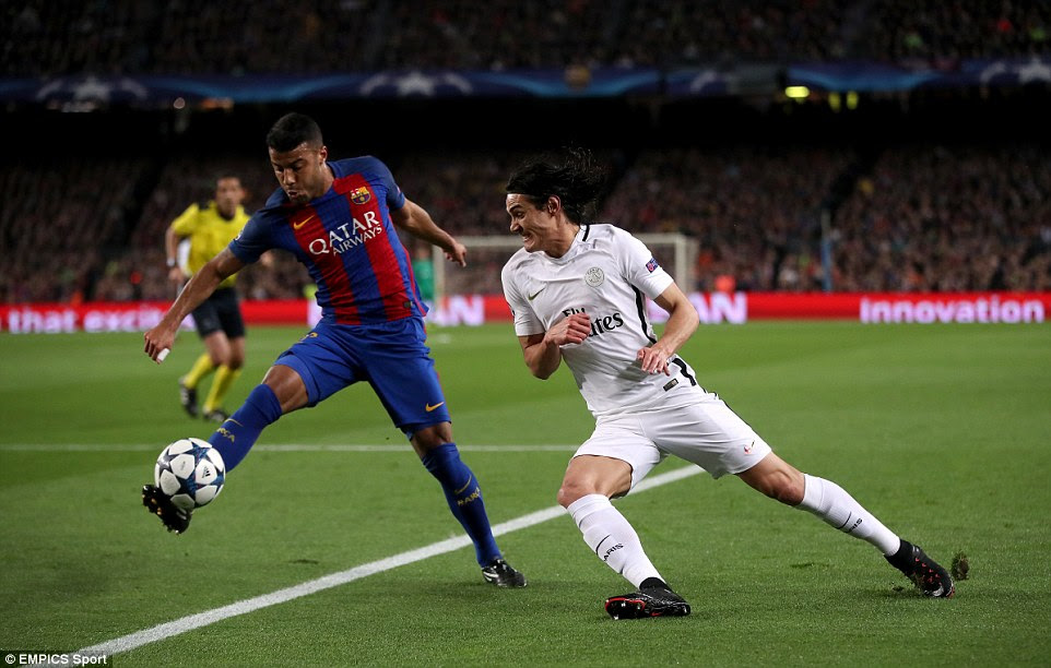 Barcelona midfielder Rafinha  gets hold of the ball and looks to keep possession as Edinson Cavani closes in