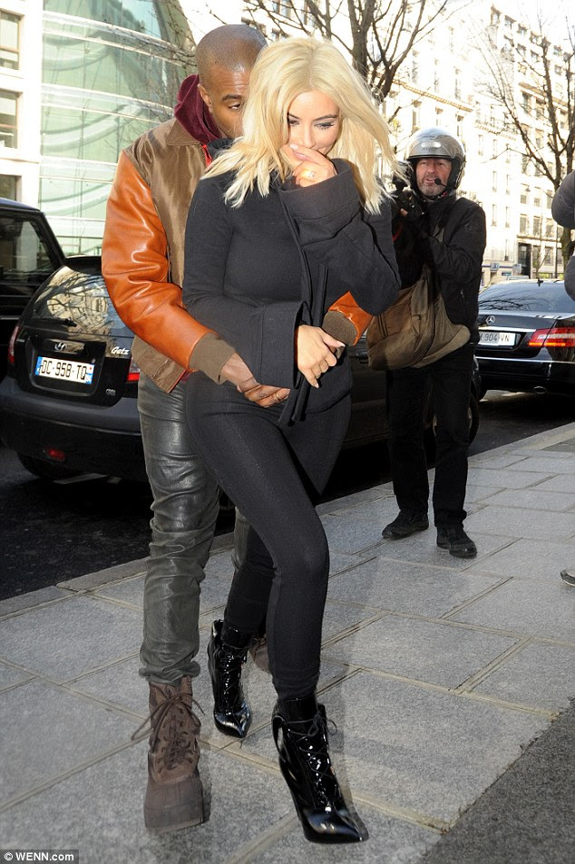 What a display! Kanye West couldn't help himself as he grabbed his wife Kim Kardashian from behind while out in Paris on Friday morning