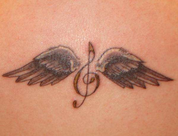 Treble Clef With Angel Wings Tattoo