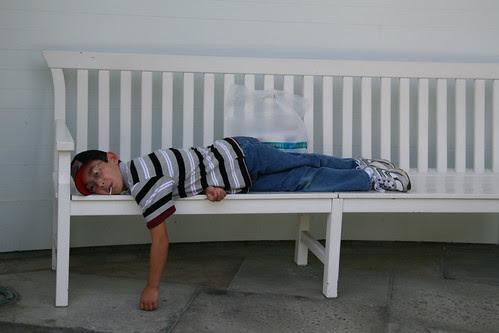 Adam lazes on the bench