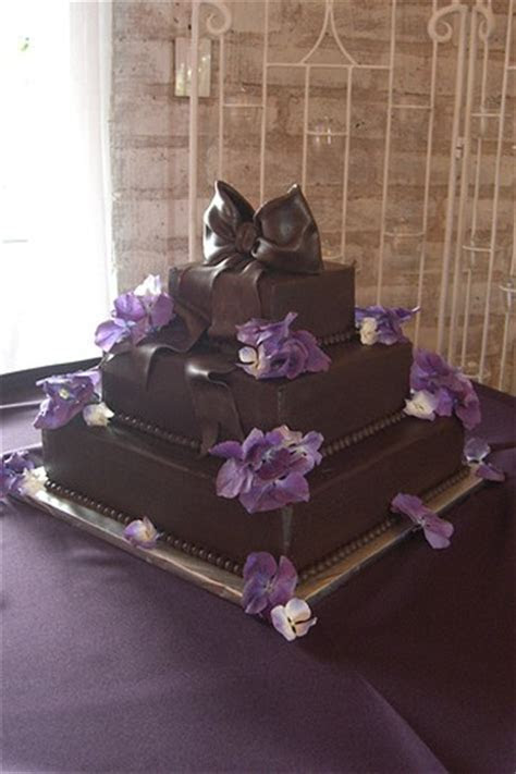 3 tier Chocolate Cake with purple flowers (2 comments)