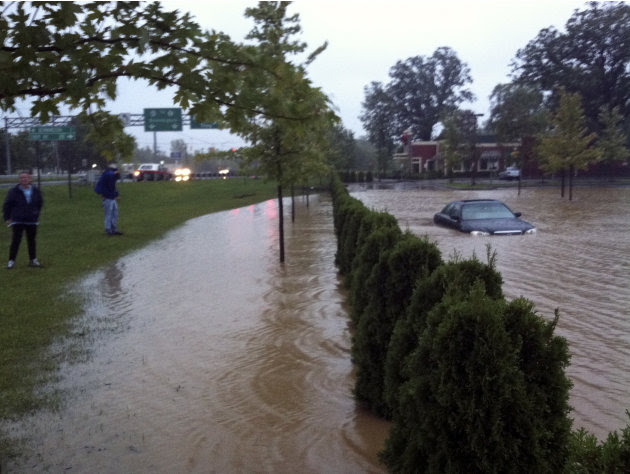 In this photo provided by Sarah Jones, a supermarket parking lot is flooded with rain water from Tropical Storm Irene in Bennington, Vt., Sunday Aug. 28, 2011. The remnants of Hurricane Irene dumped t