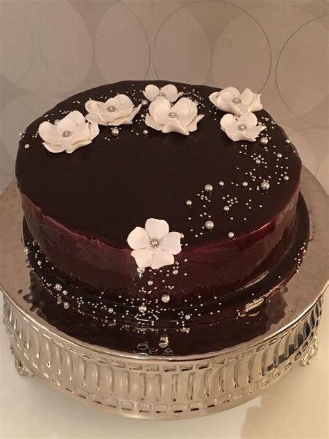 Sponge cake covered by a chocolate mirror glaze. I was so