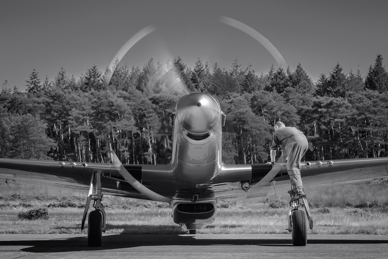 Crew Chief climbing a P-51 Mustang at the 2012 Zoersel PhotoFlying days