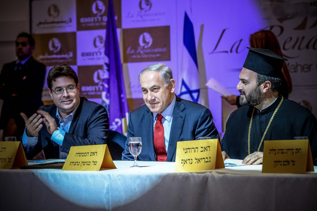 Israeli Prime Minister Benjamin Netanyahu (center) speaks at an event thrown by the Forum for Christian Enlistment in the Israel Defense Forces. Next to him is Father Gabriel Naddaf. Photo: Aviram Valdman / The Tower