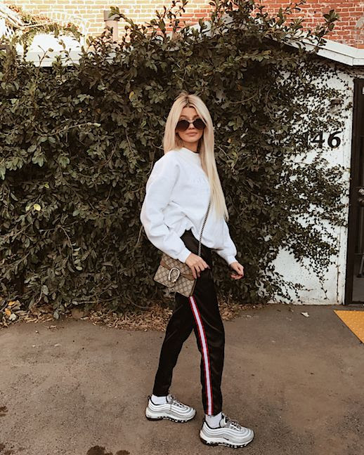 Le Fashion Blog Casual Day Off Sunglasses Sweatshirt Track Pants Crossbody Bag Sneakers Via @cheriemadeleine