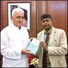 Salman Khurshid receiving a copy of the book edited by Rajiva Wijesinha