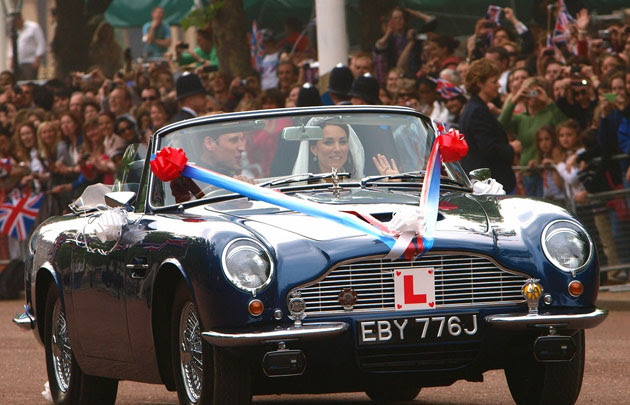 Prince William and Kate Middleton leave Royal Wedding in Aston Martin