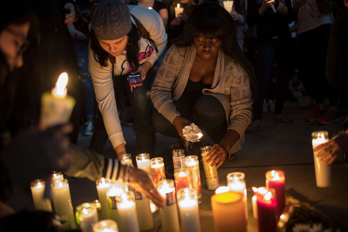 LAS VEGAS, NV - OCTOBER 2: Mourners light candles during a vigil at the corner of Sahara Avenue and Las Vegas Boulevard  for the victims of Sunday night's mass shooting, October 2, 2017 in Las Vegas, Nevada. Late Sunday night, a lone gunman killed more than 50 people and injured more than 500 people after he opened fire on a large crowd at the Route 91 Harvest Festival, a three-day country music festival. The massacre is one of the deadliest mass shooting events in U.S. history. (Photo by Drew Angerer/Getty Images)