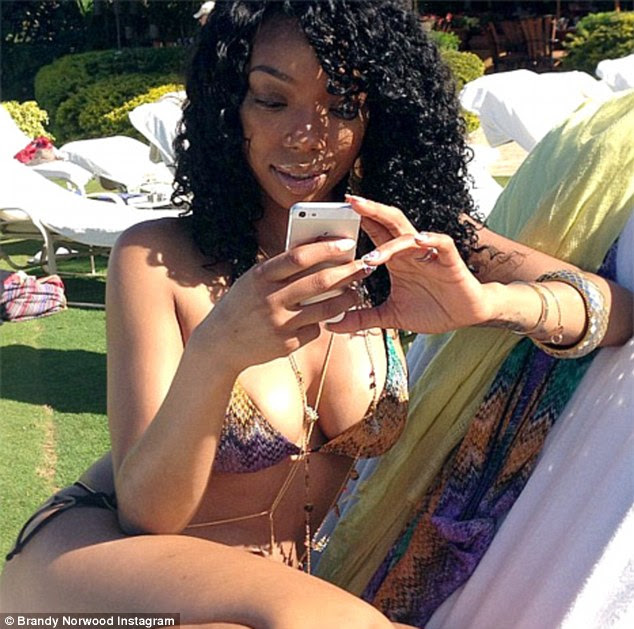 Chilling out: Brandy posted a picture of herself relaxing on holiday for all of her Twitter followers