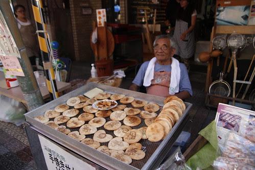 Old man selling cookies/ pancakes?