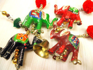 hand carved elephant ornaments via CherryBerryVintage on Etsy
