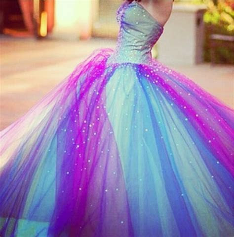A pretty light blue , pink ,and purple prom dress