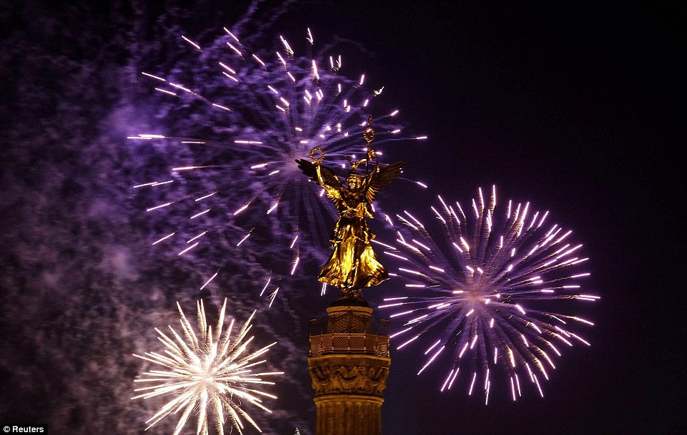 GERMANY: Fireworks explode before New Year celebrations over the 'Golden Victoria' on top of Berlin's landmark victory column