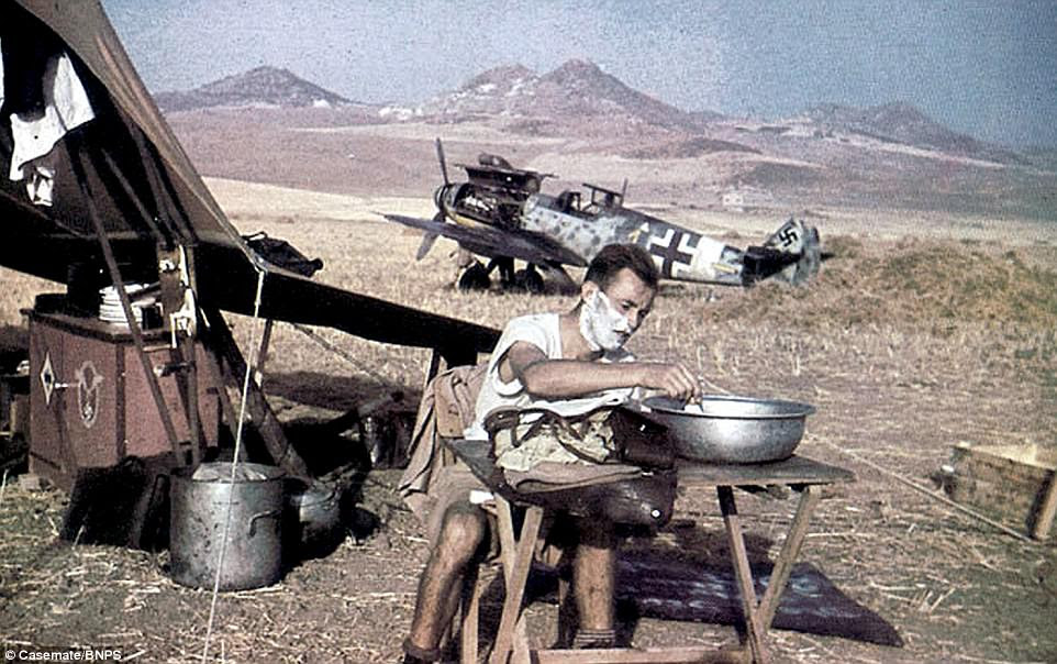 A pilot takes a moment to shave as he camps next to hisMesserschmitt Bf 109 fighter plane, somewhere in Italy, in 1943. It was during this year that the Allies launched their Italian Campaign with the invasion of Sicily