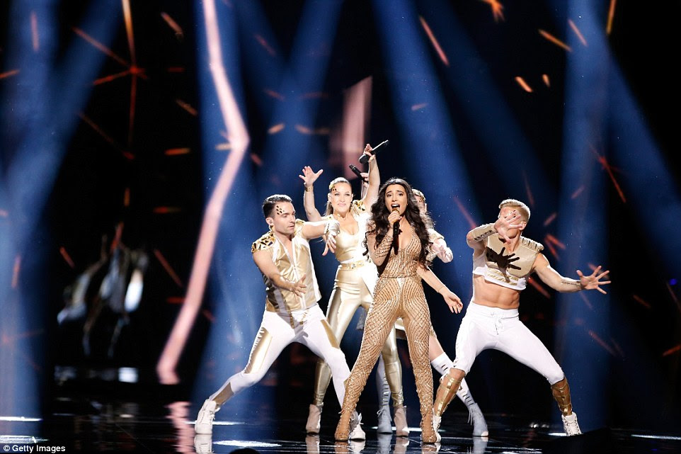 The 21-year-old grinned as she put on an energetic show surrounded by backing dancers in metallic skintight costumes