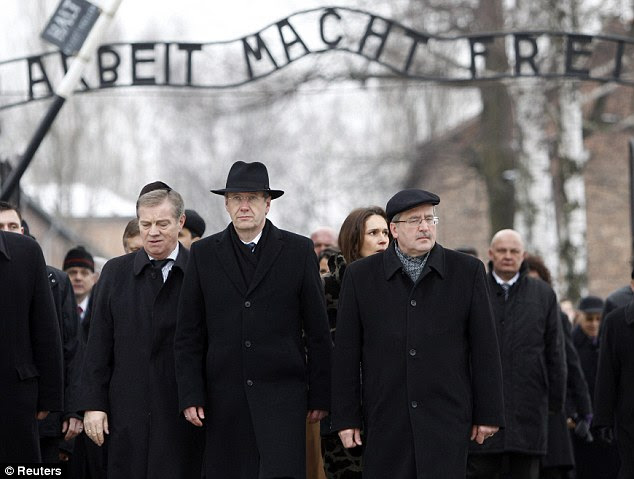 Remembrance: Heroic Polish deeds — like the Warsaw Uprising of 1944 against Nazi rule — are a foundation of the national identity, while the State has bestowed honours on Christian Poles who risked their lives to hide Jews from the Nazis. Polish President Bronislaw Komorowski (R) and German President Christian Wulff walk through the gates of Auschwitz as they mark the 66th anniversary of the liberation