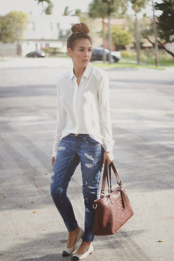 worn jeans. white shirt. simple.