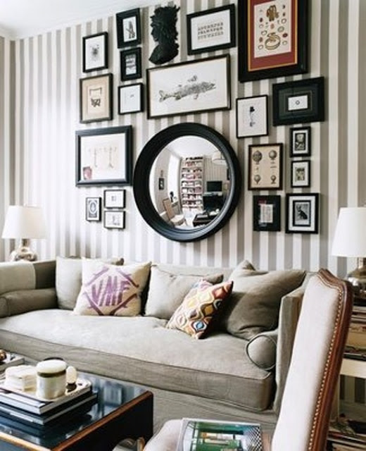 Linen covered sofa - Striped wallpaper - Gallery wall in black, white, and browns