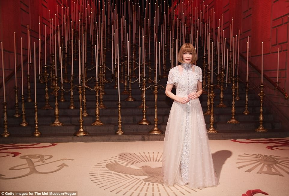 A vision: Anna Wintour made a typically sensational entrance to the incredible show as she arrived in her angelic gown
