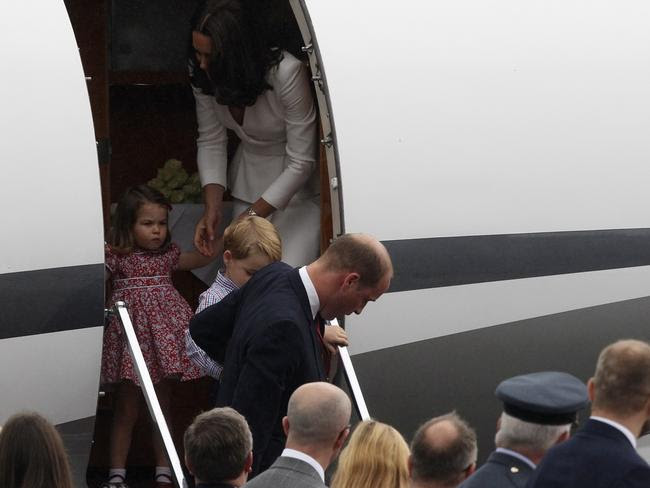 BPrince William and the Duchess of Cambridge help Prince George and Princess Charlotte from the plane. Picture: AP/Czarek Sokolowski