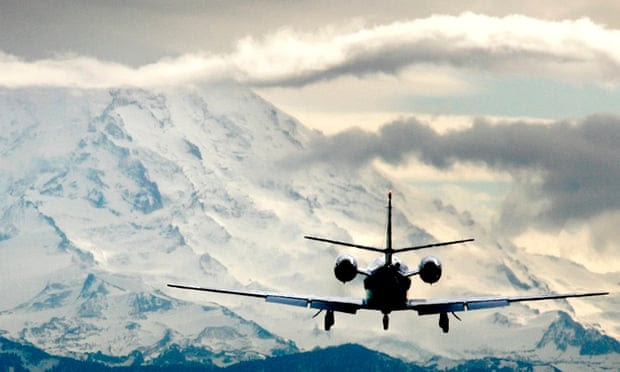 Private jet landing in the Alps