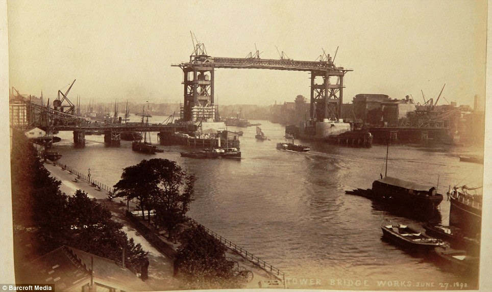 A view of the bridge: The sturdy steel frame of Tower Bridge can be seen, before it was covered with its distinctive stone-cladding on the orders of architect John Wolfe-Barry