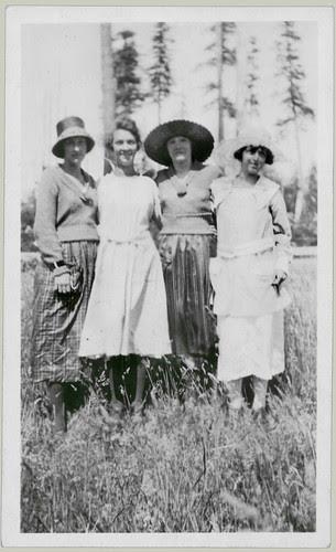 Four women, three hats