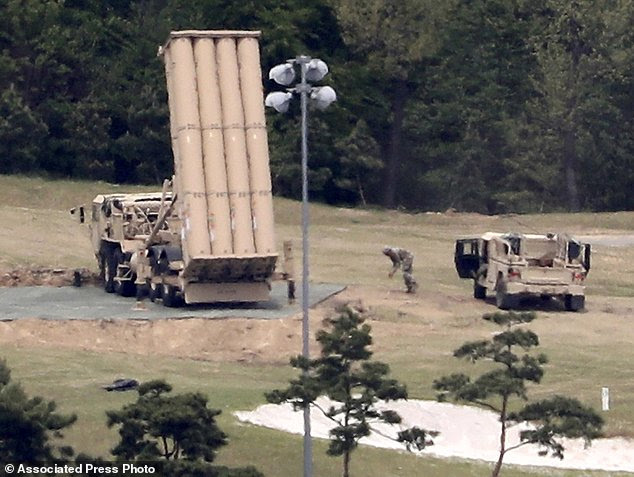 FILE - In this May 2, 2017, file photo, a U.S. missile defense system called Terminal High Altitude Area Defense (THAAD) is installed at a golf course in Seongju, South Korea. Two experts talk to The Associated Press about what would happen if North Korea fired at targets near and far. Seoul's defenses are porous. It has Patriot missile-defense batteries, but they are intended to protect against short-range Scud missiles. The much-talked-about, state-of-the-art THAAD missile defense system also cannot protect Seoul from either artillery or incoming missiles - it isn't designed to do that from its current site. (Kim Jun-beom/Yonhap via AP, File)