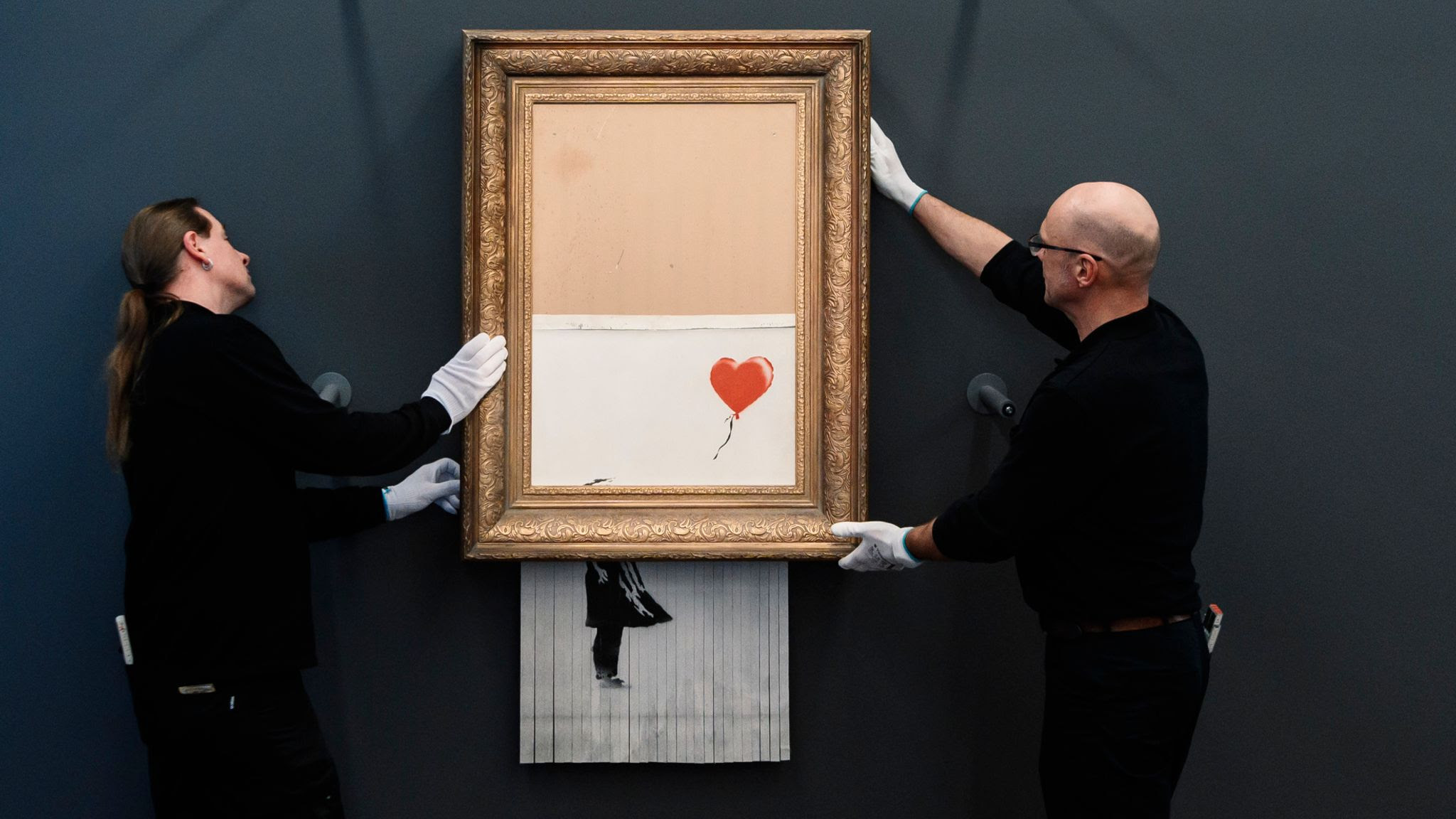 Banksy: New auction record for artist as shredded canvas Love Is In The Bin sells for £18.5m at Sotheby's