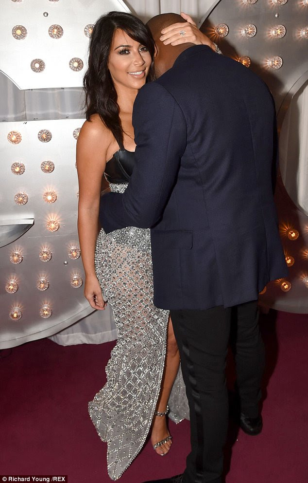 No wonder he can't keep his hands off her: Kanye was more affectionate than ever as he cuddled up to Kim