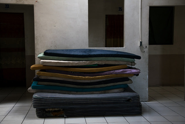 Mats and mattresses are stacked at the Hotel del Migrante, a shelter run by the organisation Angels without Borders, next to Caxelico on the U.S. border in Mexicali, capital of the northwestern Mexican state of Baja California. Credit: Ximena Natera / IPS