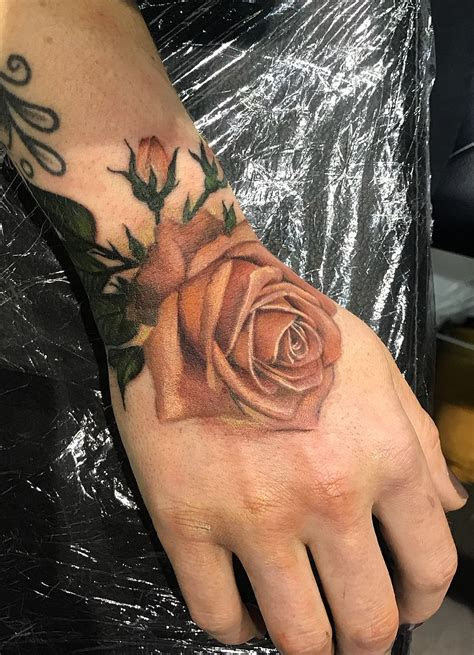 awesome rose tattoo hand tattoo artist bethany rivers