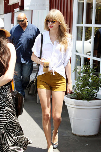 Taylor Swift goes retro glam in a simple white shirt and shorts