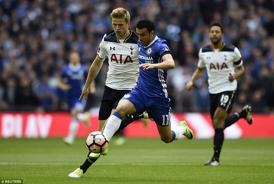 Tottenham midfielder Eric Dier puts pressure on Chelsea forward Pedro as he looks to launch a counter attack