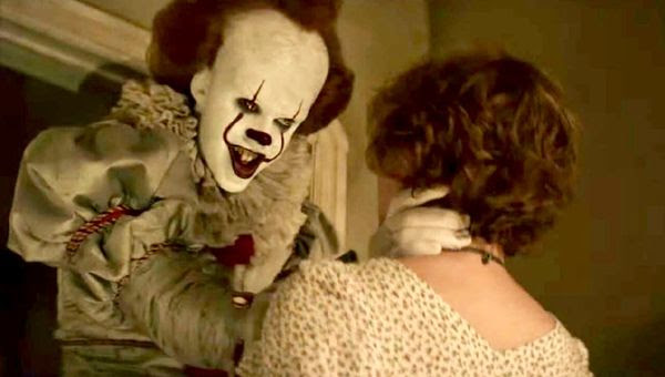 Pennywise the Dancing Clown confronts Beverly Marsh (Sophia Lillis) in IT.
