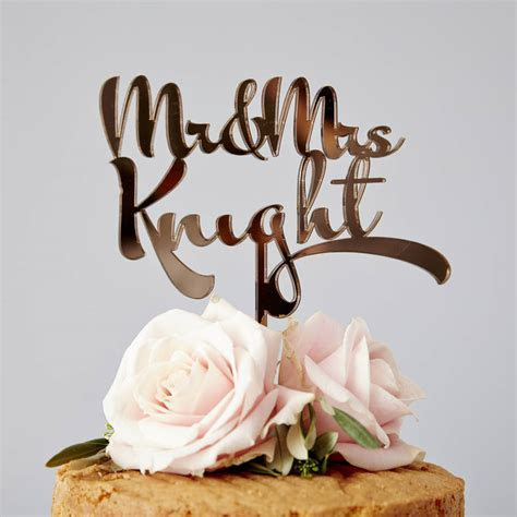 personalised calligraphy wedding cake topper by sophia